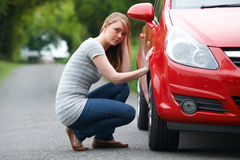 Young Female Motorist With Puncture On Country Road Royalty Free Stock Photo