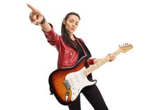 Young female musician with a bass electric guitar. Isolated on white background royalty free stock photos