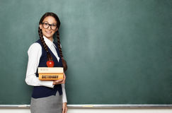 Young female nerd with books Royalty Free Stock Photos