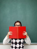 Young female nerd holding book royalty free stock images
