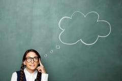 Young female nerd thinking Stock Photo