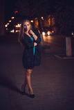 Young female in night city Royalty Free Stock Photography