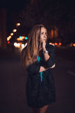Young female in night city Stock Images