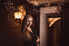 Young female in night city Royalty Free Stock Photos