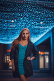Young female in night city Royalty Free Stock Images