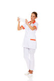 Young female nurse or doctor holding a bandage Stock Photo