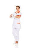 Young female nurse or doctor holding a bandage Royalty Free Stock Photos