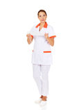 Young female nurse or doctor holding a bandage Royalty Free Stock Photography