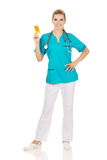 Young female nurse or doctor holding pills Stock Image