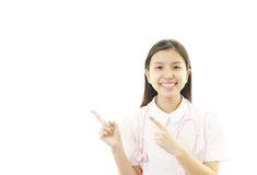 Young female nurse pointing. Portrait of an Asian female nurse Royalty Free Stock Image