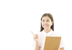 Young female nurse pointing. Portrait of an Asian female nurse Royalty Free Stock Photo