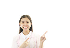 Young female nurse pointing. Portrait of an Asian female nurse Stock Images