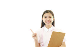 Young female nurse pointing. Portrait of an Asian female nurse Stock Photography