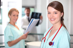 Young female nurse Stock Images