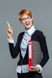 Young female office worker gesturing an idea with her finger Royalty Free Stock Photos