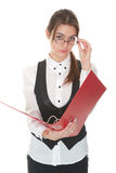 Young female office worker reading report Royalty Free Stock Photography