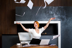 Young female office worker  throws the paper Royalty Free Stock Photos