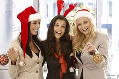 Young female office workers in santa hat Stock Image