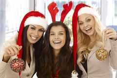 Young female office workers in santa hat Royalty Free Stock Photos