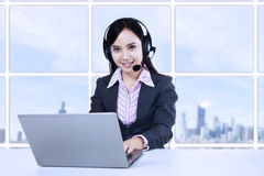 Young female operator with headphones Royalty Free Stock Image