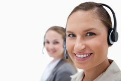 Young female operators using headsets Royalty Free Stock Photos