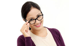 Young female optician showing eye glasses. Against white stock photos