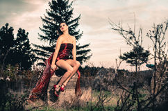 Young female outdoors in short red dress Stock Photo