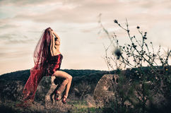 Young female outdoors in short red dress Royalty Free Stock Photography