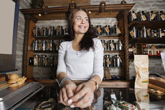 Young female owner looking away in tea store Stock Images