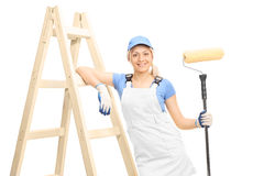 Young female painter holding a paint roller Royalty Free Stock Photos