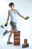 Young female painter holding trowel royalty free stock photography