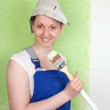 Young female painter with paintbrush Royalty Free Stock Photo