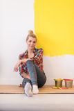 Young female painter sitting on floor stock photography