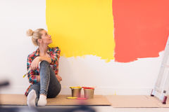 Young female painter sitting on floor stock image