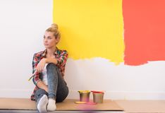 Young female painter sitting on floor Royalty Free Stock Images