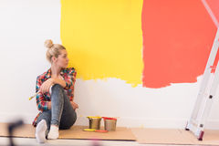 Young female painter sitting on floor Royalty Free Stock Photo