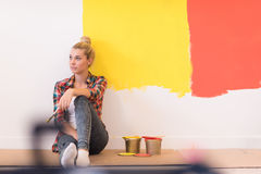 Young female painter sitting on floor Stock Photo