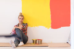 Young female painter sitting on floor Royalty Free Stock Photos