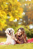 Young female in a park with her dog Stock Photo