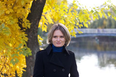 Young female in park in October Stock Photography