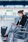 Young female passenger at the airport, Stock Photos