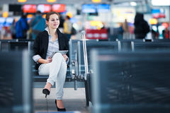 Young female passenger at the airport, Stock Image