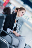 Young female passenger at the airport, Stock Photo