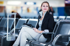 Young female passenger at the airport Royalty Free Stock Image