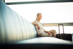 Young female passenger at the airport Stock Image