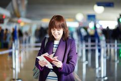 Young female passenger at check-in counter Royalty Free Stock Images
