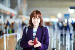 Young female passenger at check-in counter Stock Image