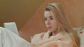 Young female patient use digital tablet in hospital bed stock footage