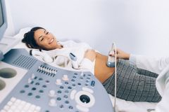 Young female patinet have ulstrasound examination of the abdomen. In hospital Royalty Free Stock Image