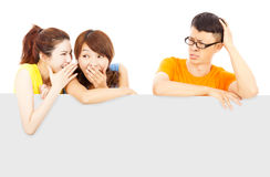 Young female people whisper about the man events. Young female people whisper about the men events in studio Royalty Free Stock Photography
